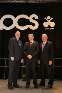 Photo: AOCS. Miller on stage at the 2014 American Oil Chemists' Society meeting in Texas, with AOCS technical director Richard Cantrill and fellow Australian Rod Mailer.